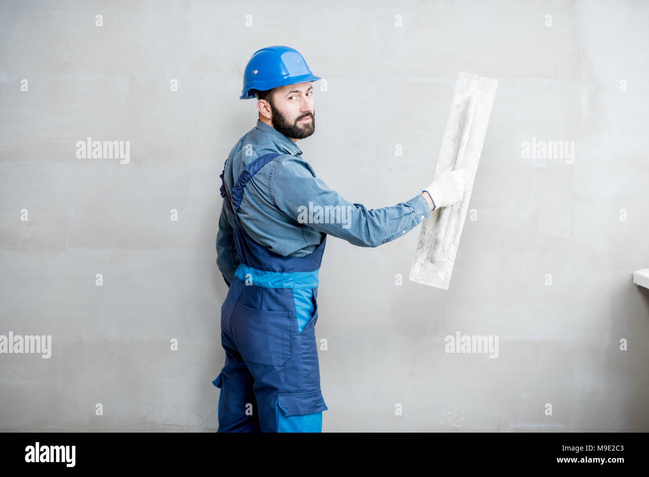 Plasterer working indoors Stock Photo