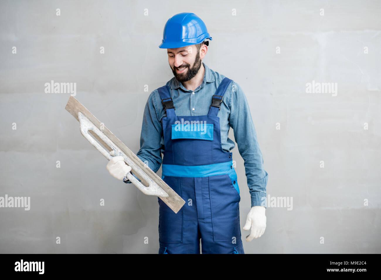 Plasterer working indoors Stock Photo