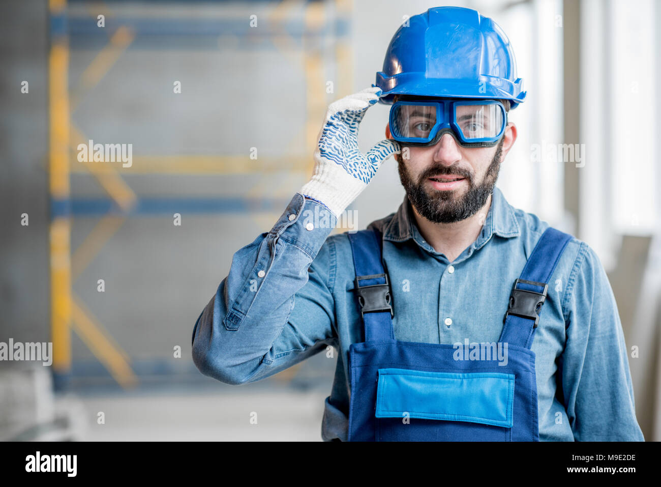 Builder in uniform indoors Stock Photo
