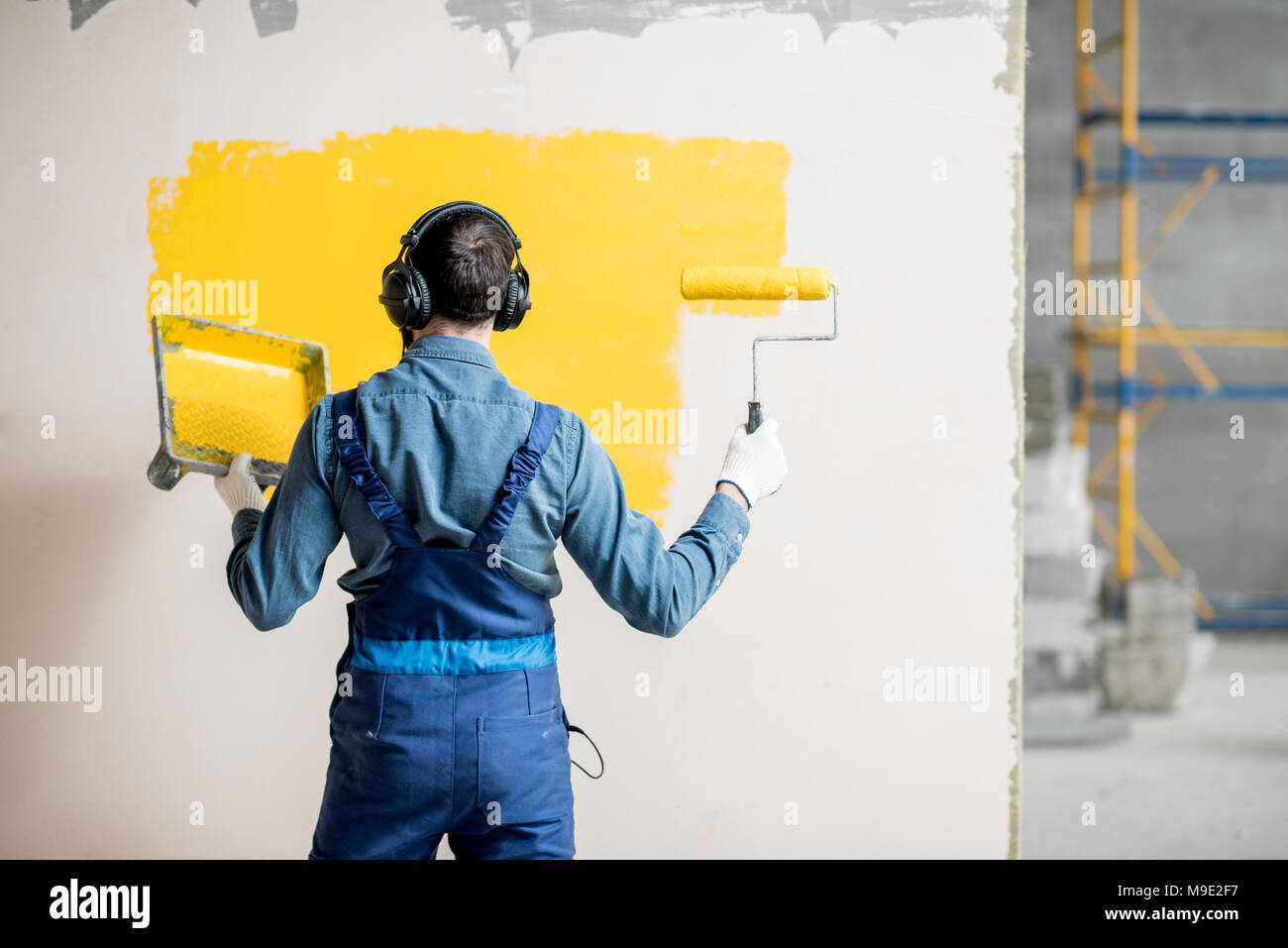 Painter listening to the music during the work - Stock Image