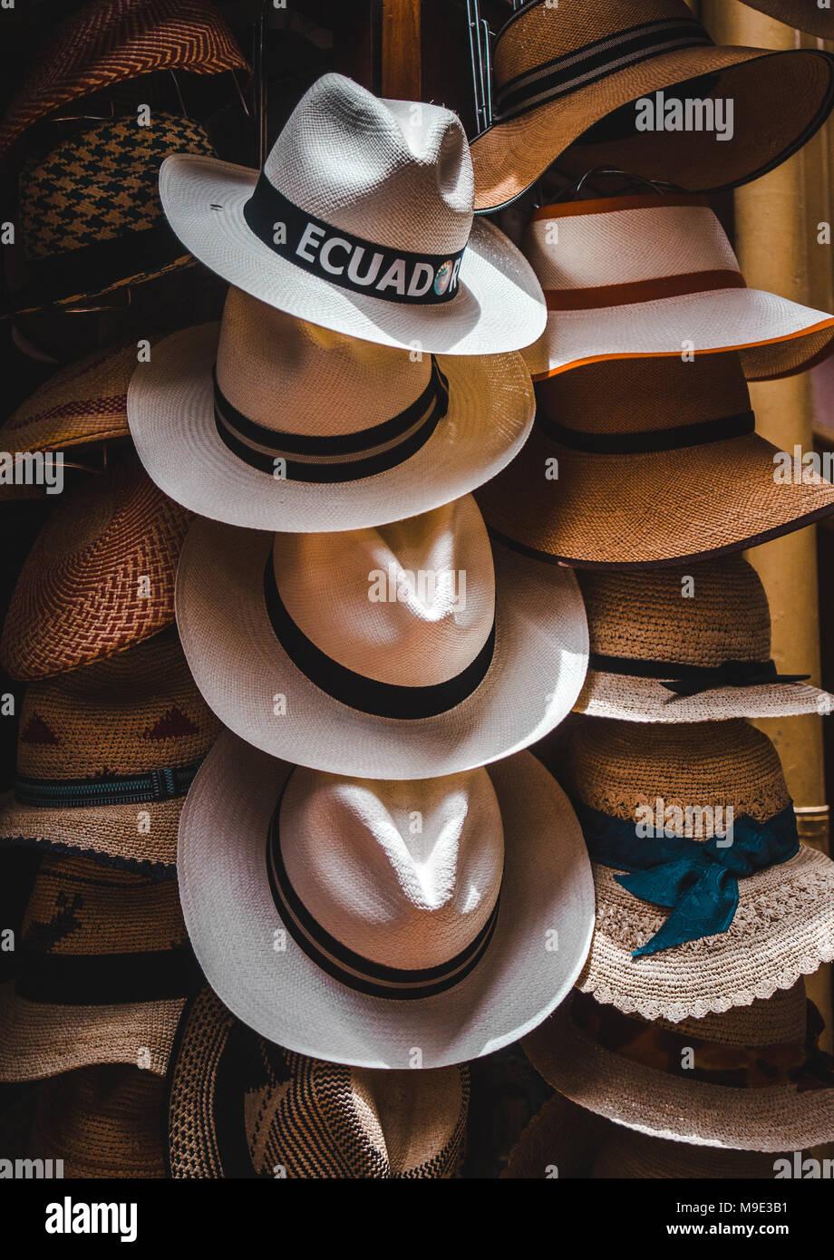 9fe50020 Handmade Ecuadorian Panama hats with black bands on display in a shop in  Cuenca, Ecuador