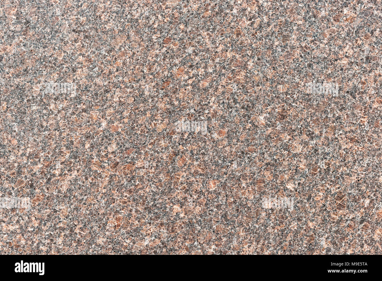 Polished granite stone plate of brown color made for decoration purposes - Stock Image