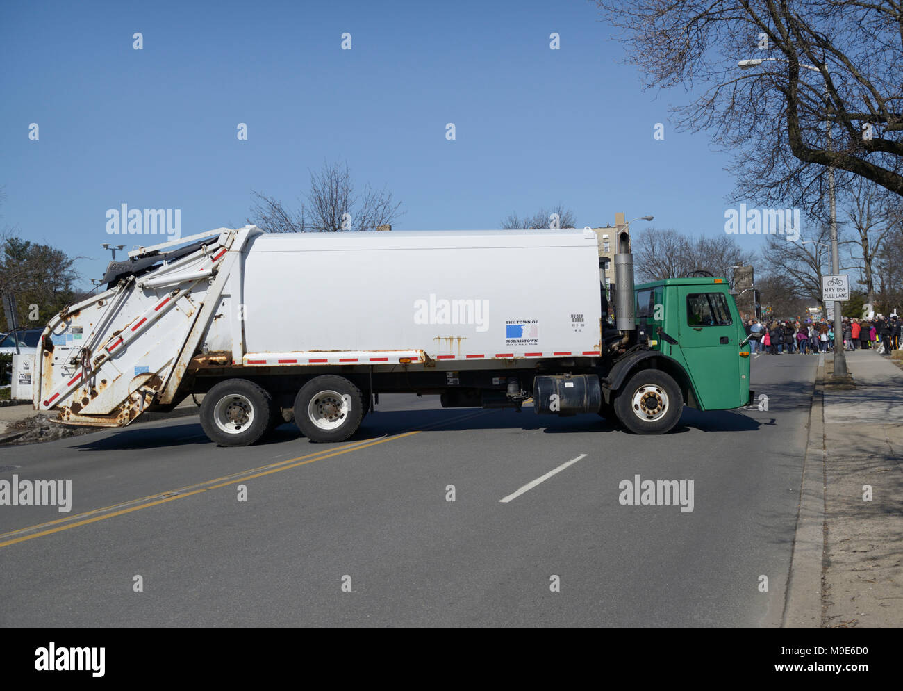 Garbage truck used to block off area to prevent terrorist attack by vehicle during a public march, NJ - Stock Image