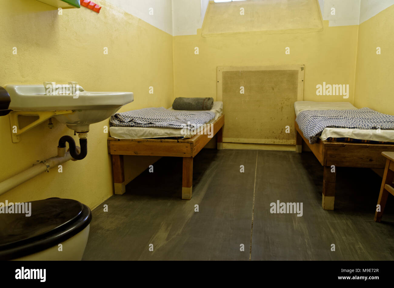 Leipzig, Germany - June 12, 2015. Jail cell with two bunk beds and sink are exposed in the Stasi Museum in Leipzig, Germany Stock Photo