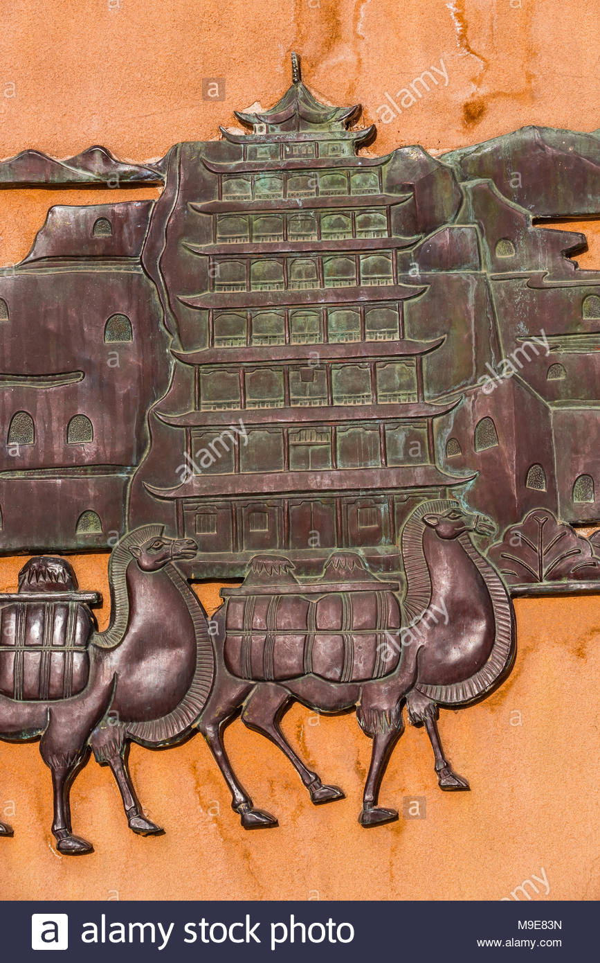 A bronze bas-relief depicting the Silk Road at Jiayuguan Fort is the western end of the Great Wall built in the Ming Dynasty (1368 – 1644). It was an - Stock Image