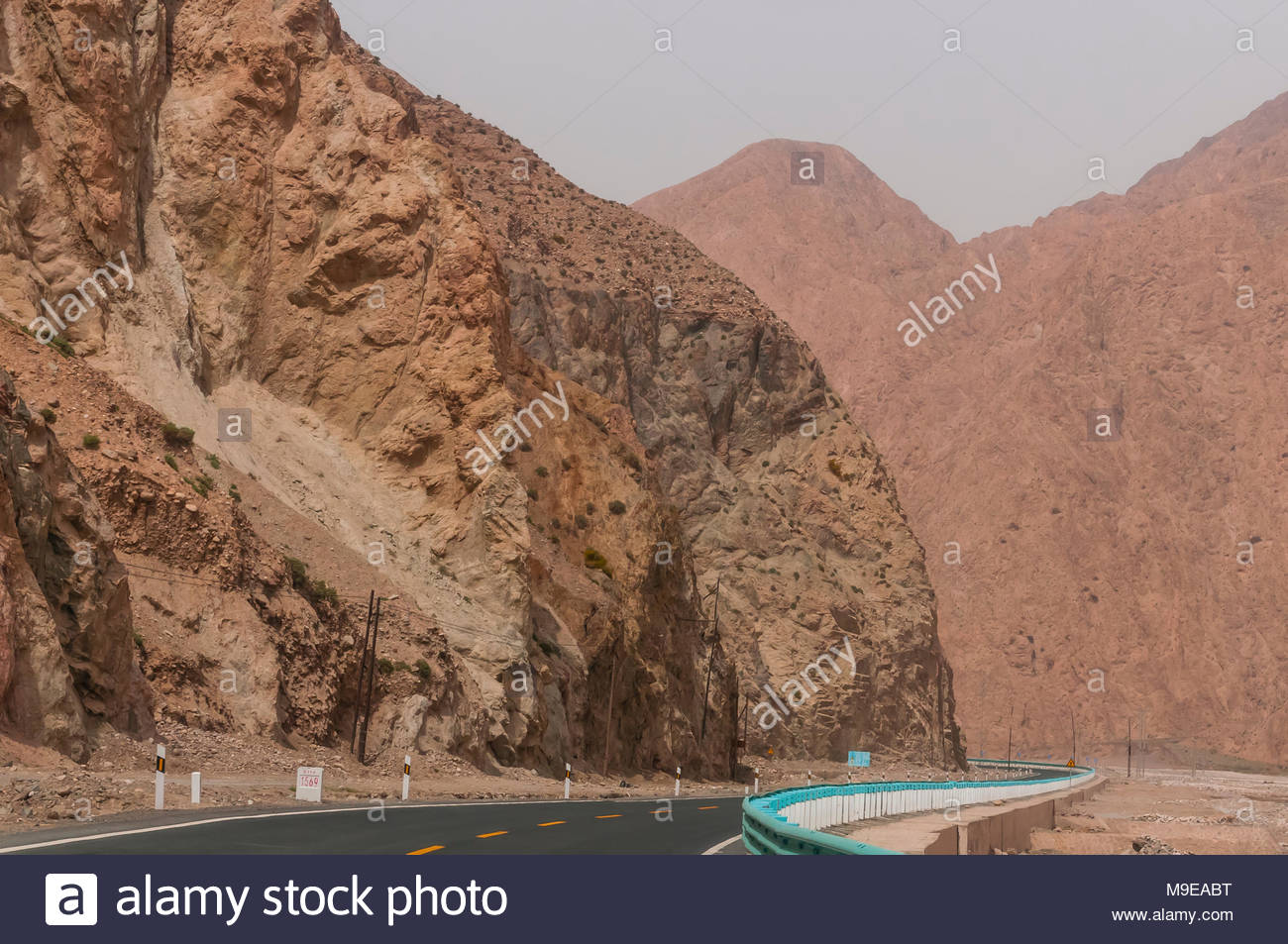 Karakoram Highway passing through the Pamir Mountains in Xinjiang China. It is the highest paved international road in the world; it connects Western - Stock Image
