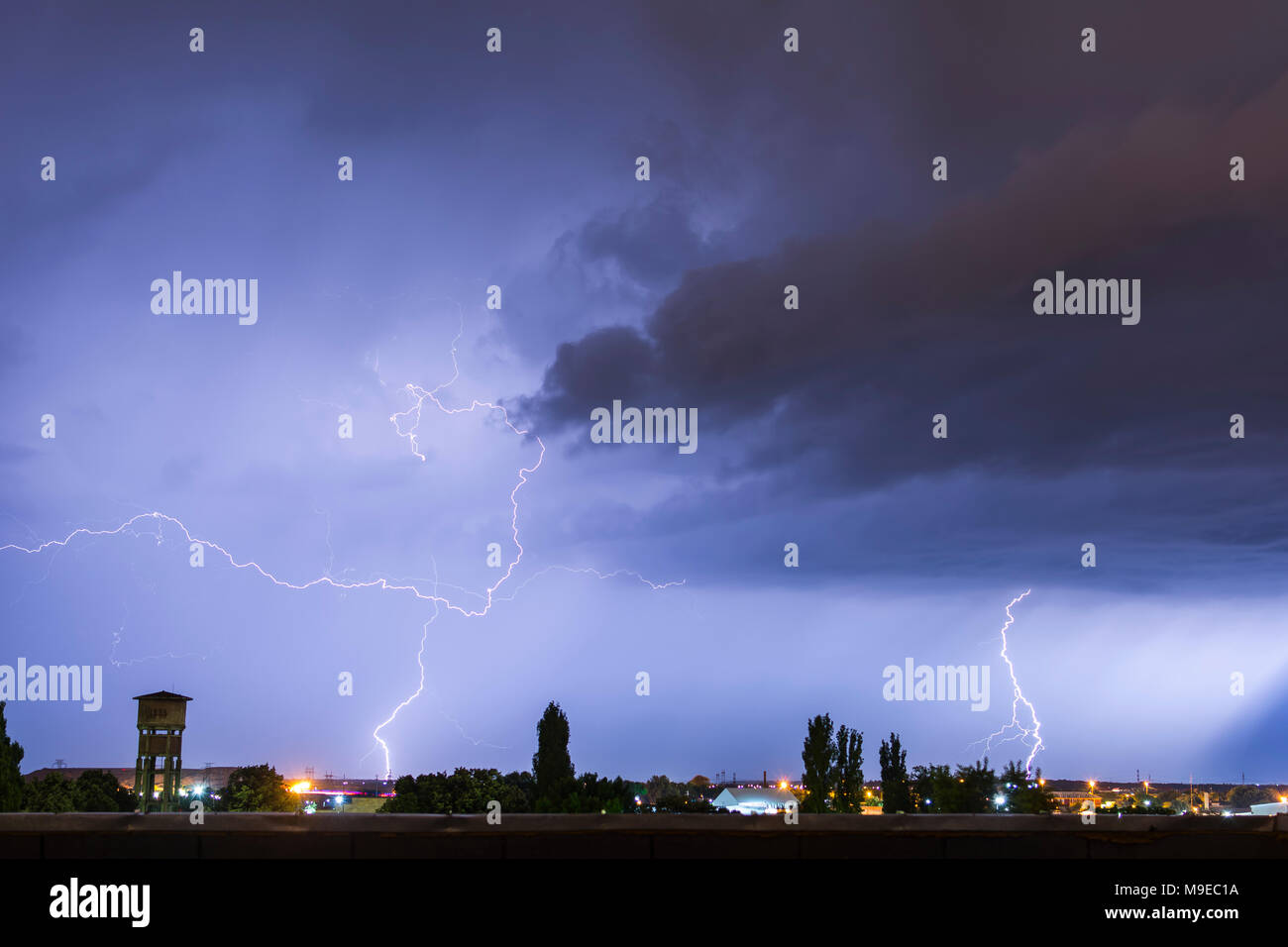 Lightning flash over a city, Thunderstorm , electricity blast storm, thunderbolt in sky Stock Photo