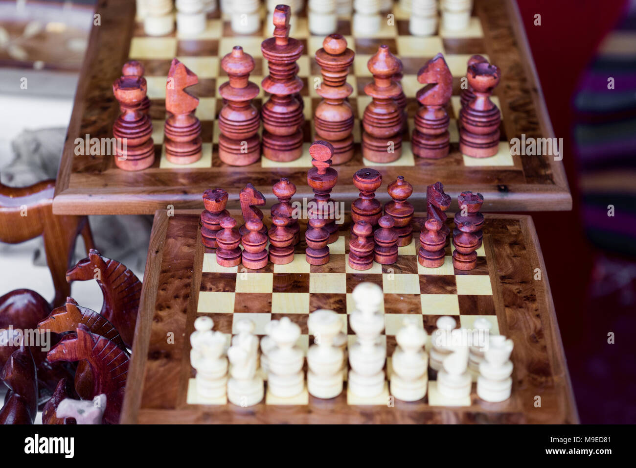 Wooden chessboard game with arranged wooden chess figures ready for playing - Stock Image