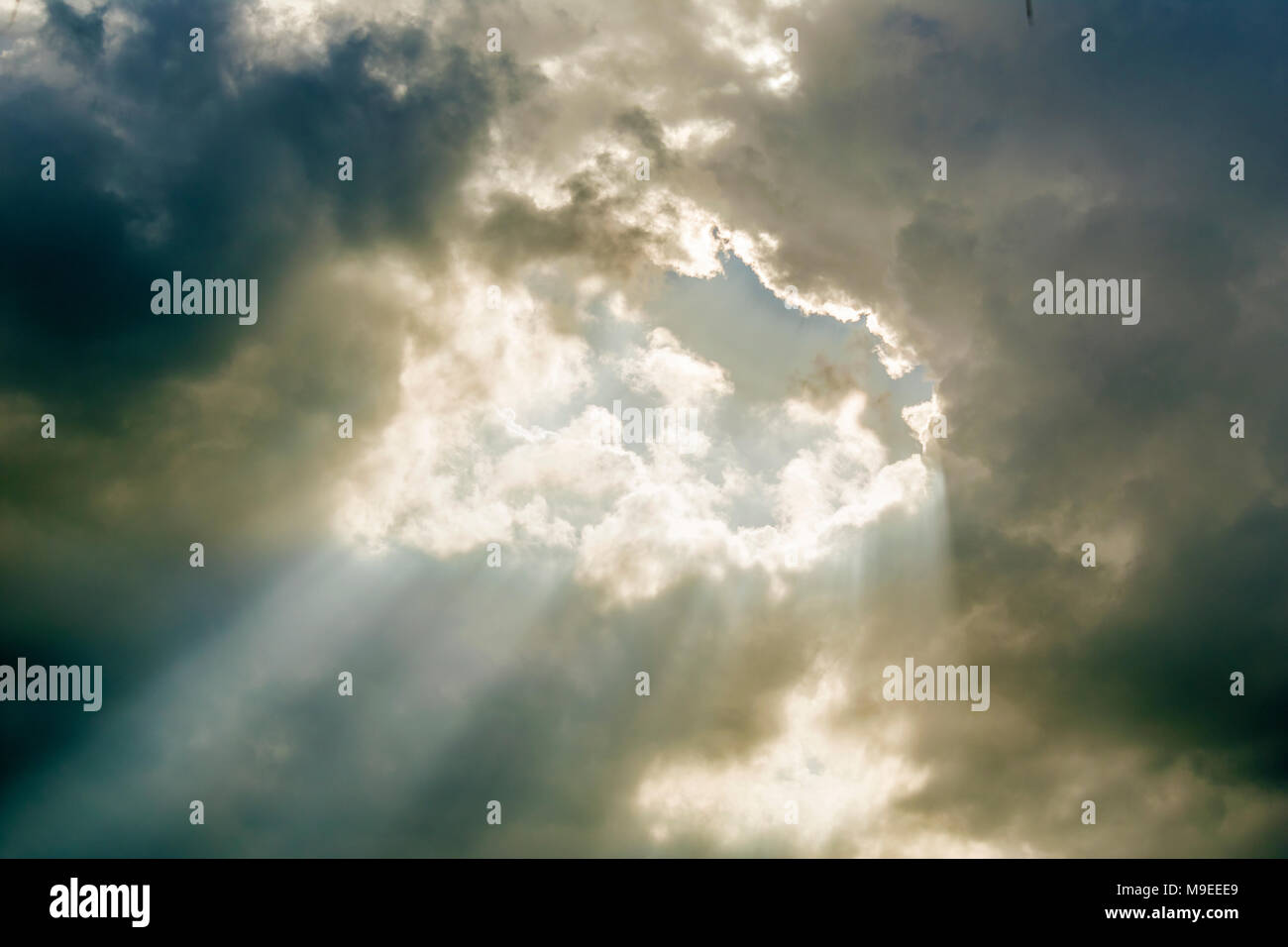 Gray clouds with sunny shines. - Stock Image