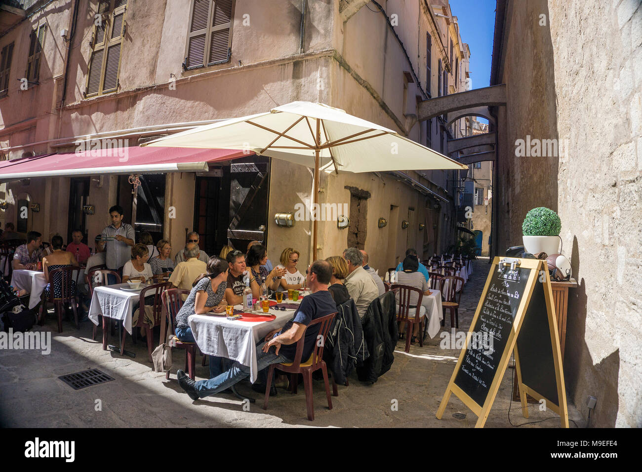 Idyllic restaurant at old town of Bonifacio, Corsica, France, Mediterranean, Europe - Stock Image