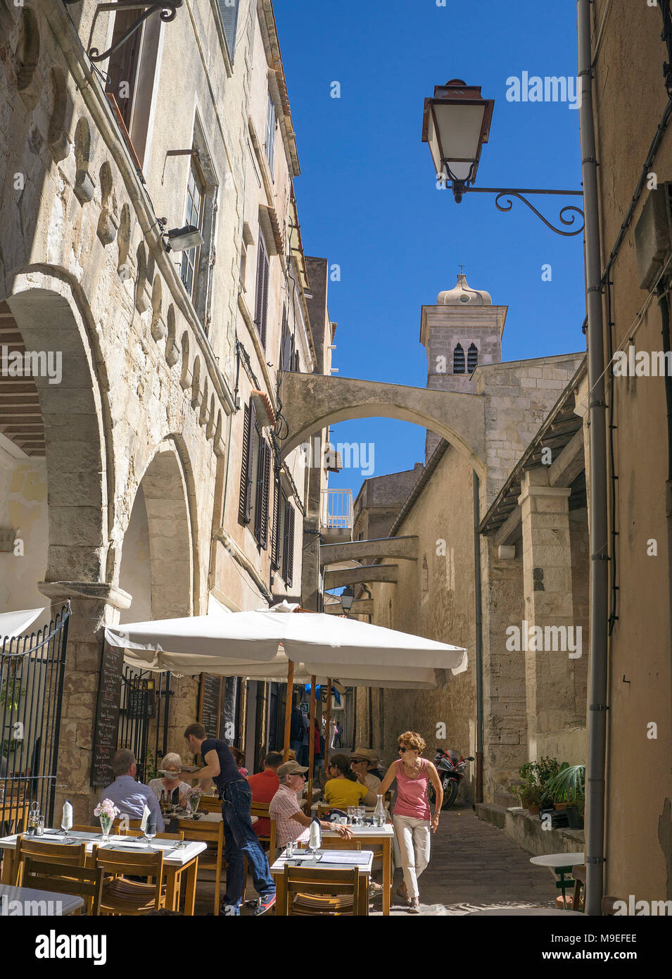 Idyllic restaurant at old town, behind the church Eglise Sainte Marie Majeure, Bonifacio, Corsica, France, Mediterranean, Europe - Stock Image