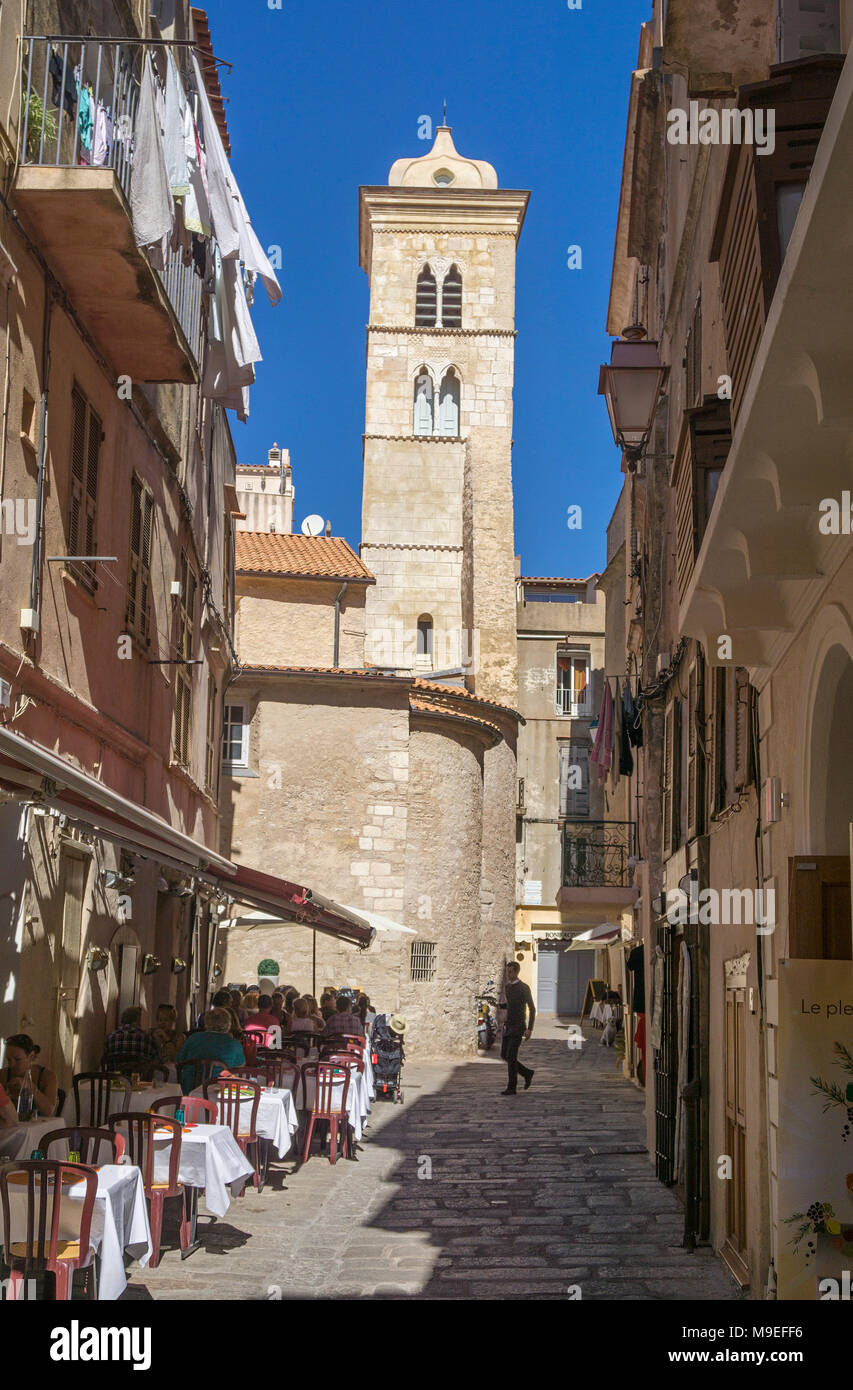 IIdyllic restaurant at church Eglise Sainte Marie Majeure, old town of Bonifacio, Corsica, France, Mediterranean, Europe - Stock Image