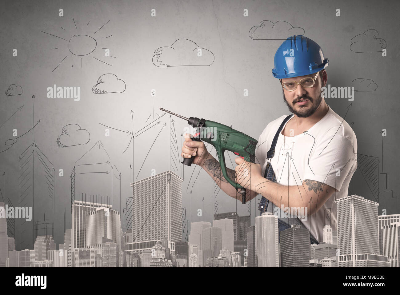 Handyman with tool in his hand and cityscape nearby. Stock Photo