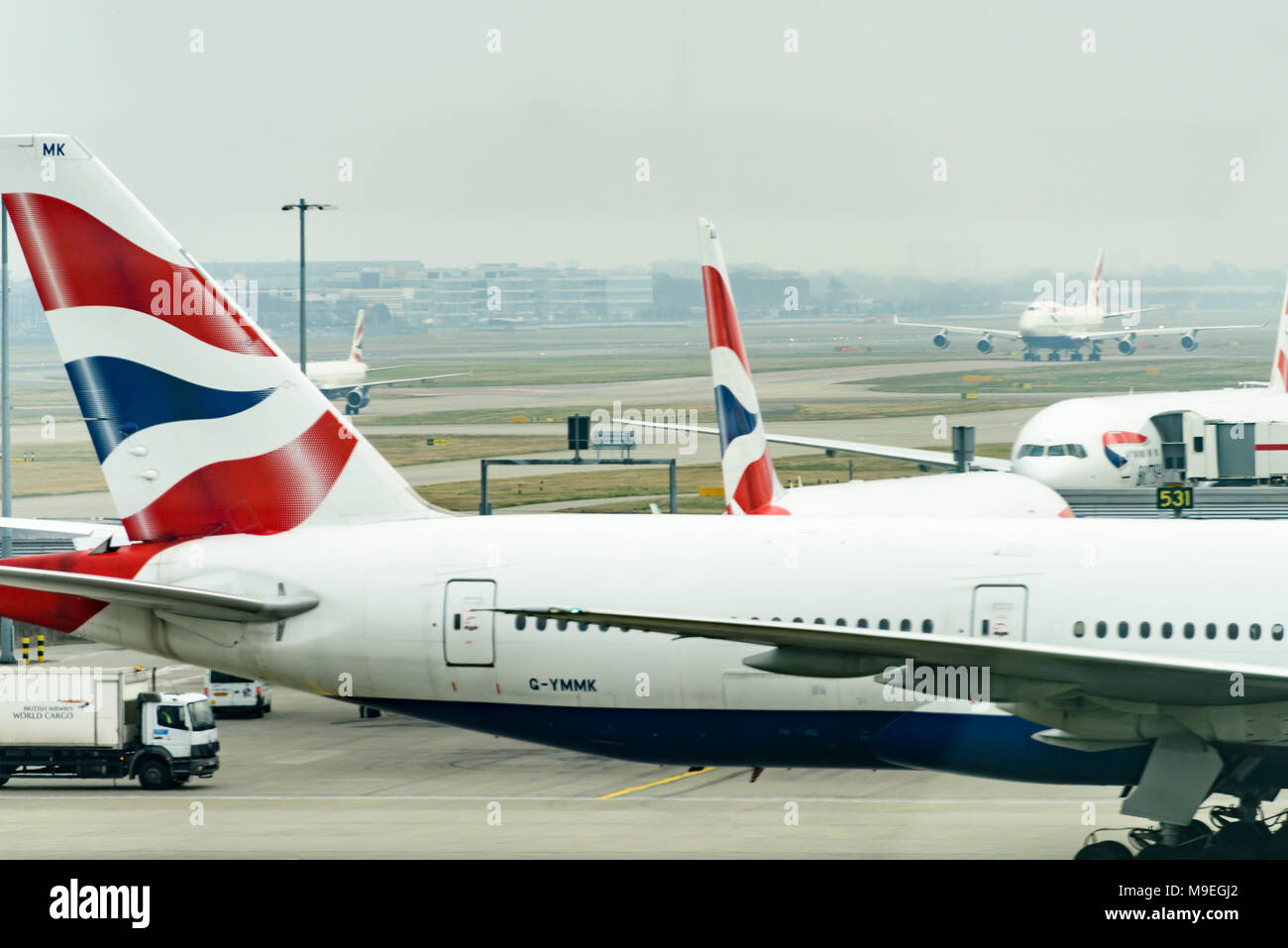 British Airways planes and tailfins at Heathrow Airport, London, England, UK Stock Photo