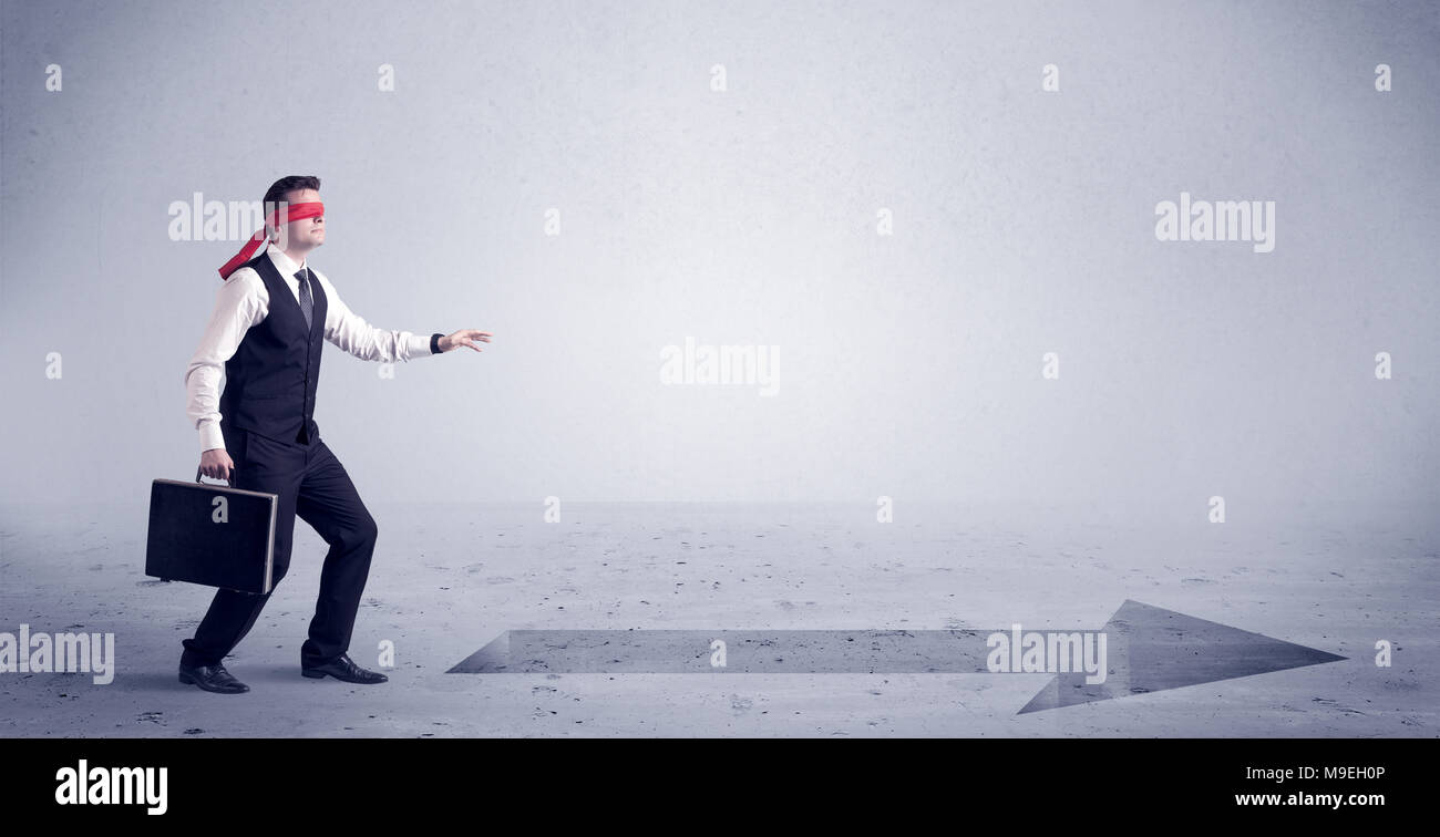 A Confused Blind Salesman Standing In Front Of A Drawn Arrow On