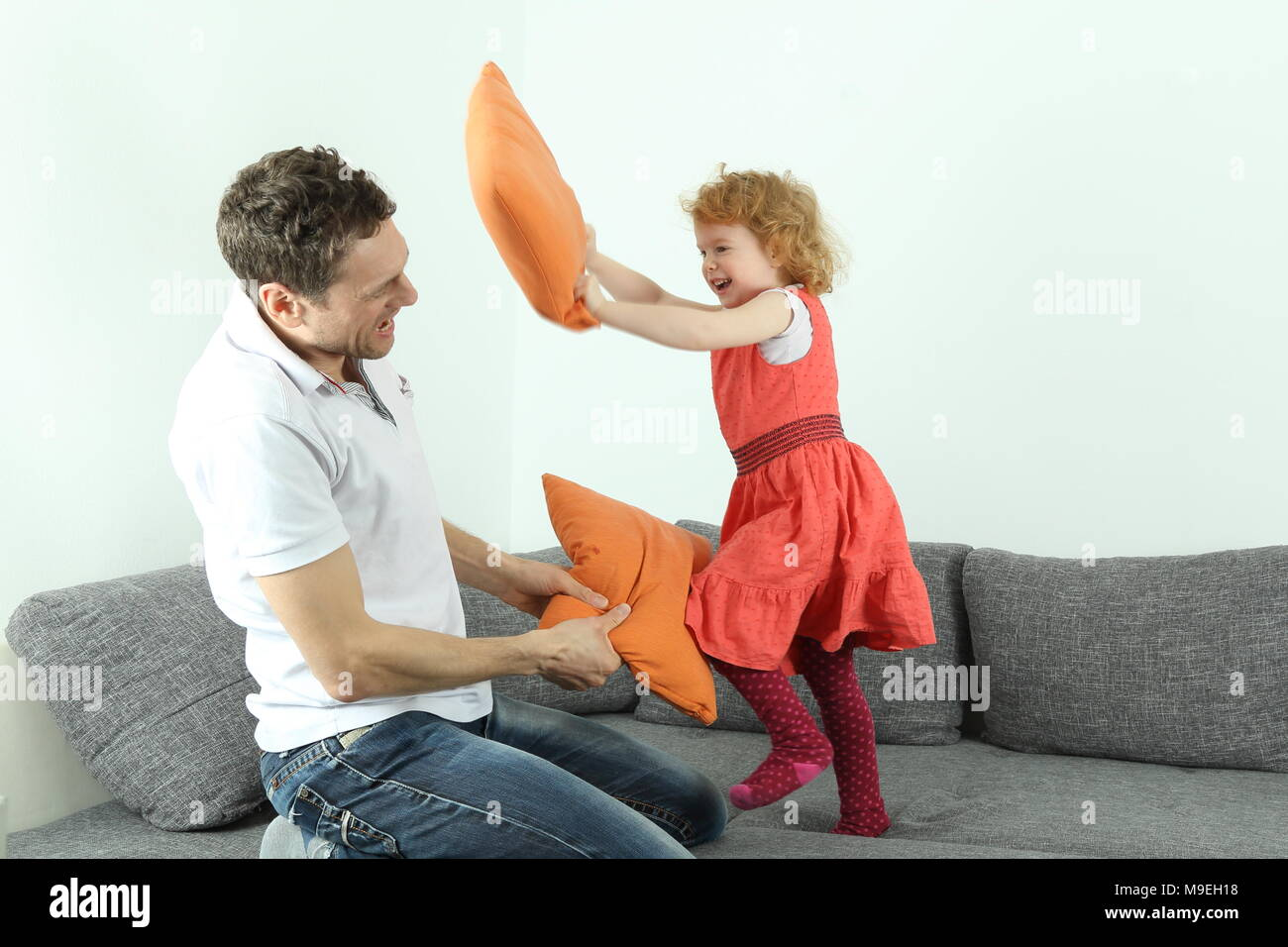 A Pillow fight dad with child or father with daughter - Stock Image