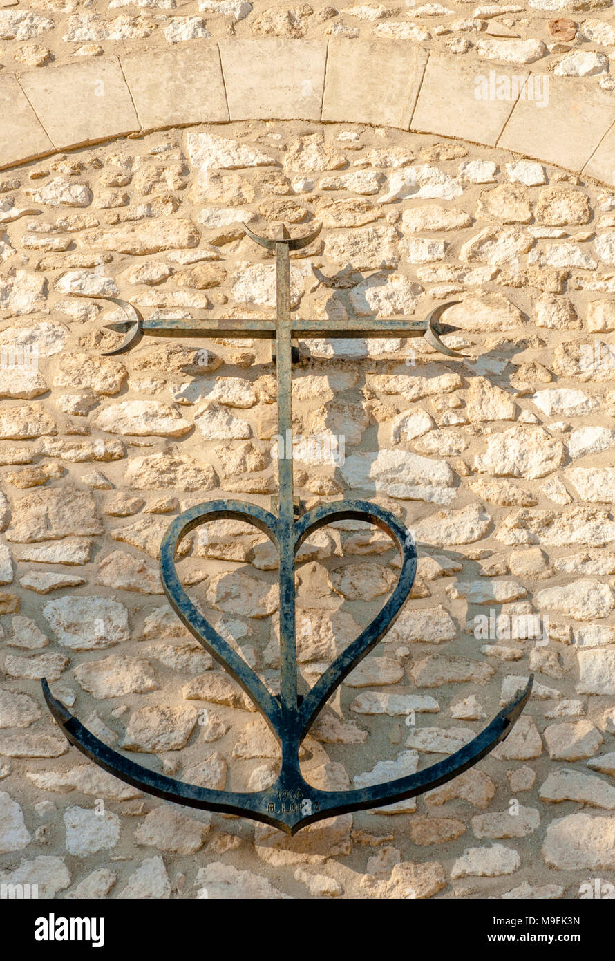 The anchored heart is a typical symbol of the Camargue region in the south of France and often found particularly on church walls. - Stock Image