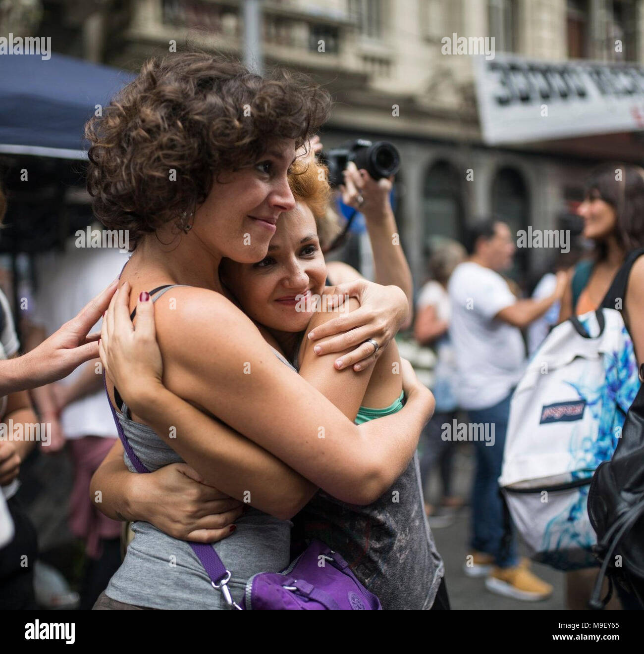 24 March 2018, Argentina, Buenos Aires: Two women embrance at a protest. 42 years after the last military coup, children and grandchildren of the torturers of the former miliary dictatorship march on the 'Day of Remembrance' to protest against the reduction of sentences for their criminal family members. Photo: Nicolas Villalobos/dpa Stock Photo