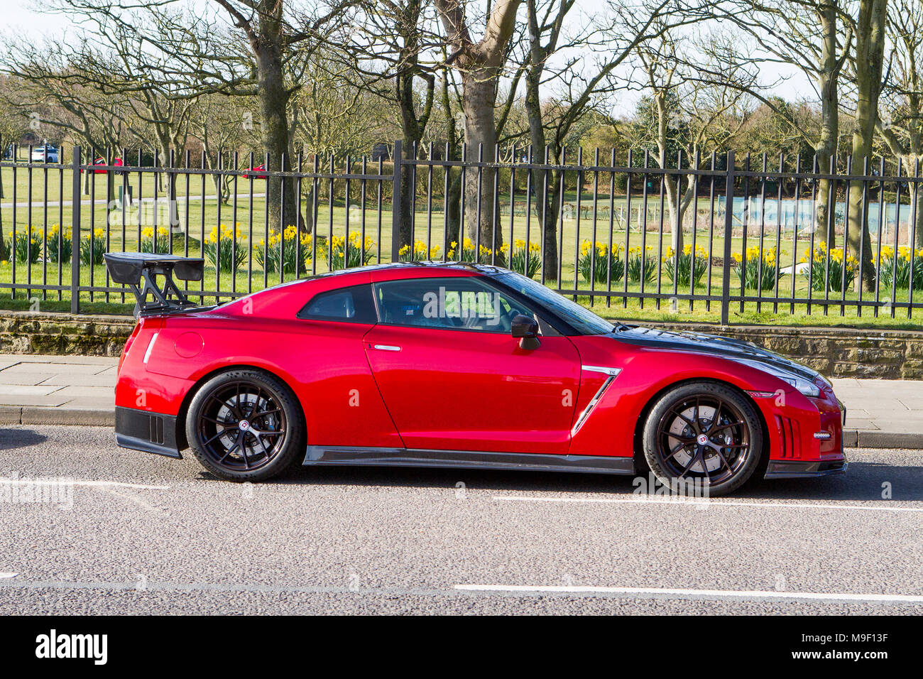 Merseyside, UK, 25 Mar 2018. Supercars of the North West 1st Event of the Season. 25th March 2018.  Organisers Gage and Thomas Bleakley said they are expecting over 200 cars to turn up to the event which is held in the Victoria park gardens in Southport, Merseyside.  Vehicles of all ages from British Mini classics to full V8 American muscle cars roar into Southport for this show event which brings thousands of visitors to the seaside resort.  Credit: Cernan Elias/Alamy Live News - Stock Image