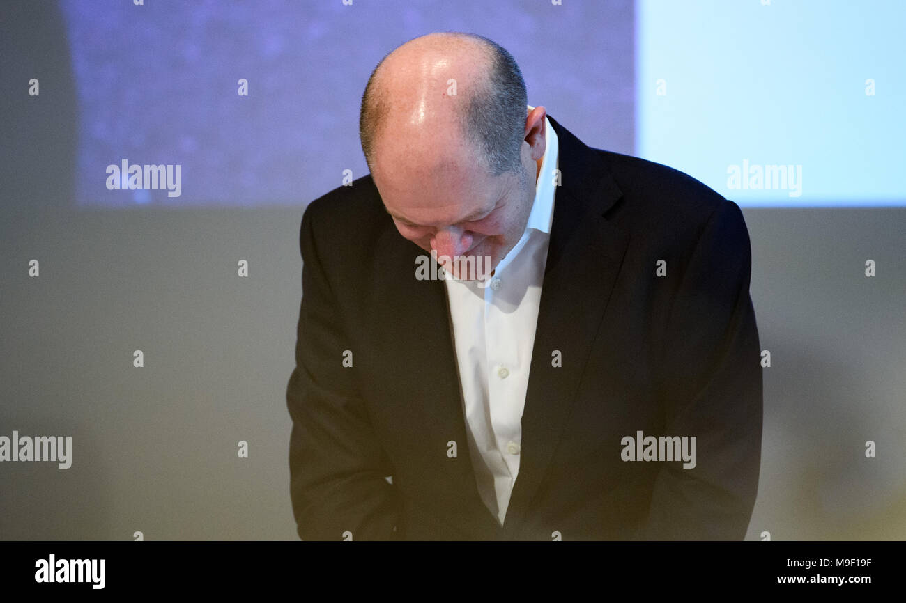 24 March 2018, Germany, Hamburg: Finance Minister Olaf Scholz of the Social Democratic Party (SPD) bows after giving a speech at a special regional meeting of his party. Photo: Daniel Reinhardt/dpa Stock Photo