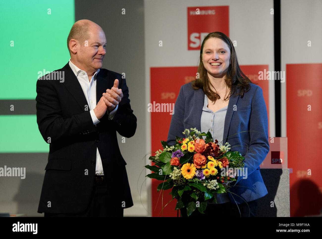 24 March 2018, Germany, Hamburg: Melanie Leonhard of the Social Democratic Party (SPD) smiles after being appointed the new regional SPD-leader at a special meeting of her party. Her predecessor Olaf Scholz applauds. Photo: Daniel Reinhardt/dpa Stock Photo
