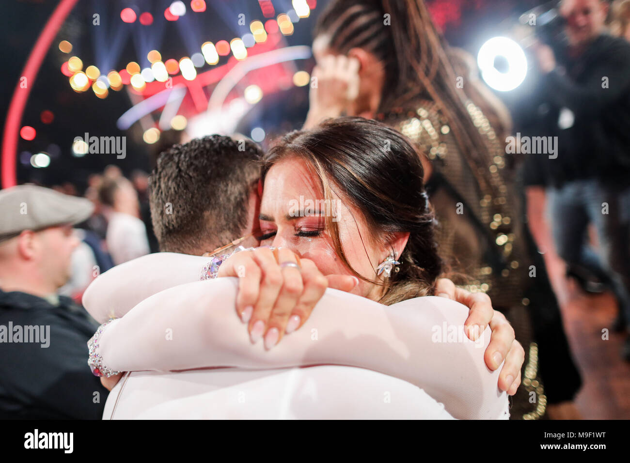23 March 2018, Germany, Cologne: Bachelorette Jessica Paszka is consoled by professional dancer Robert Beitsch after being voted out of the celebrity dance competition 'Let's Dance', broadcast by television channel RTL. Photo: Rolf Vennenbernd/dpa - Stock Image