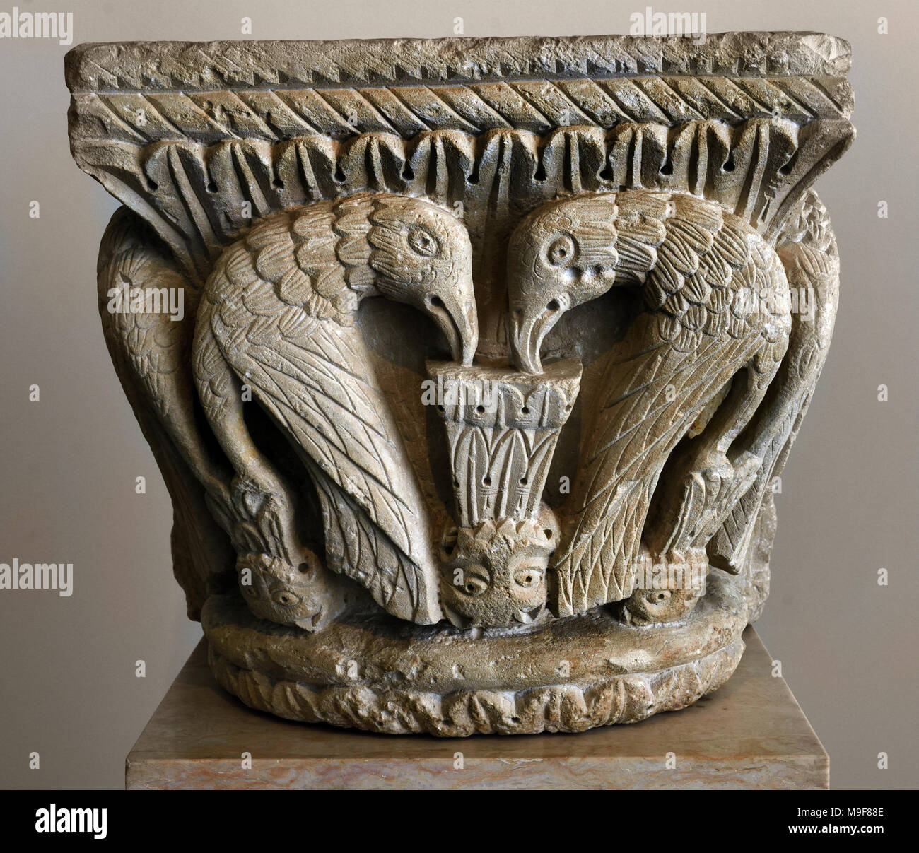 Mermaid Capital 12th century Portugal, Portuguese, ( Capital, rich in iconography, depicts a typical Romanesque theme – the mermaid is holding a fish in her right hand and raising her tail in the other. Church of San Pedro. ) - Stock Image