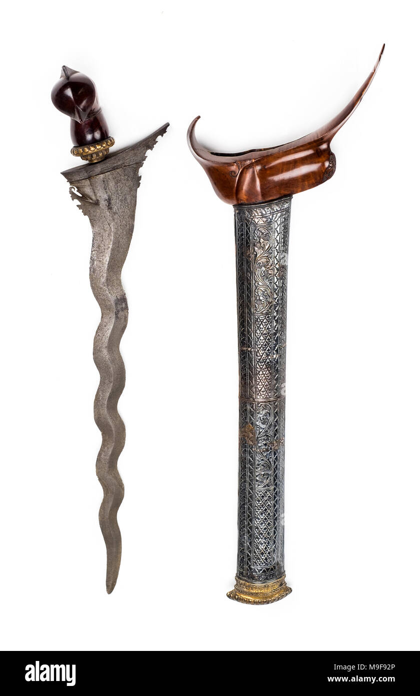 Antique 19th century Kris dagger from Java with wavy iron blade, carved wood Garuda hilt and complete with original scabbard - Stock Image