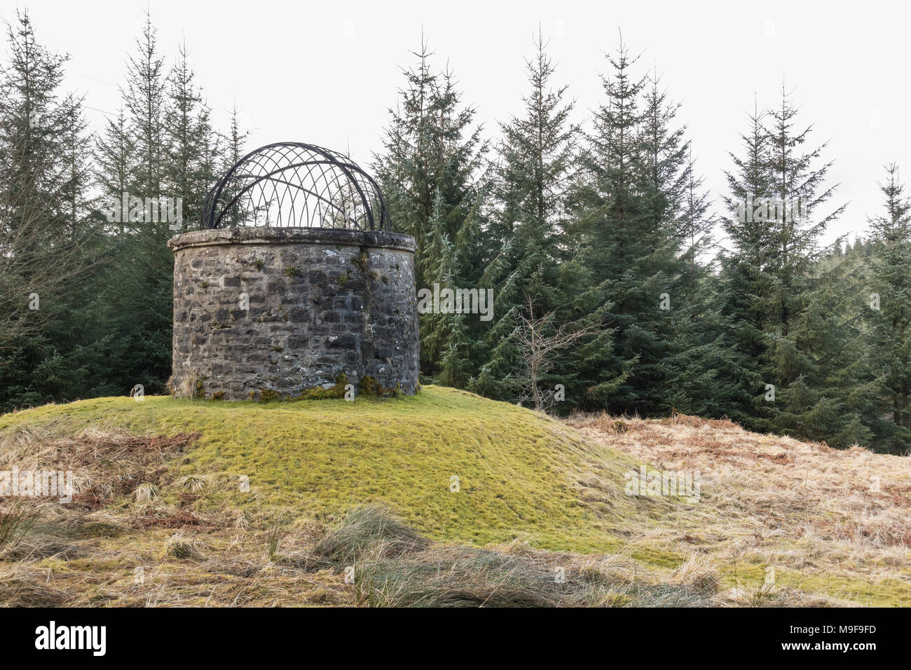 Circular ventilation shaft with hooped birdcage top, Loch Katrine pipeline on the Rob Roy Way between Drymen and Aberfoyle, Scotland, UK - Stock Image