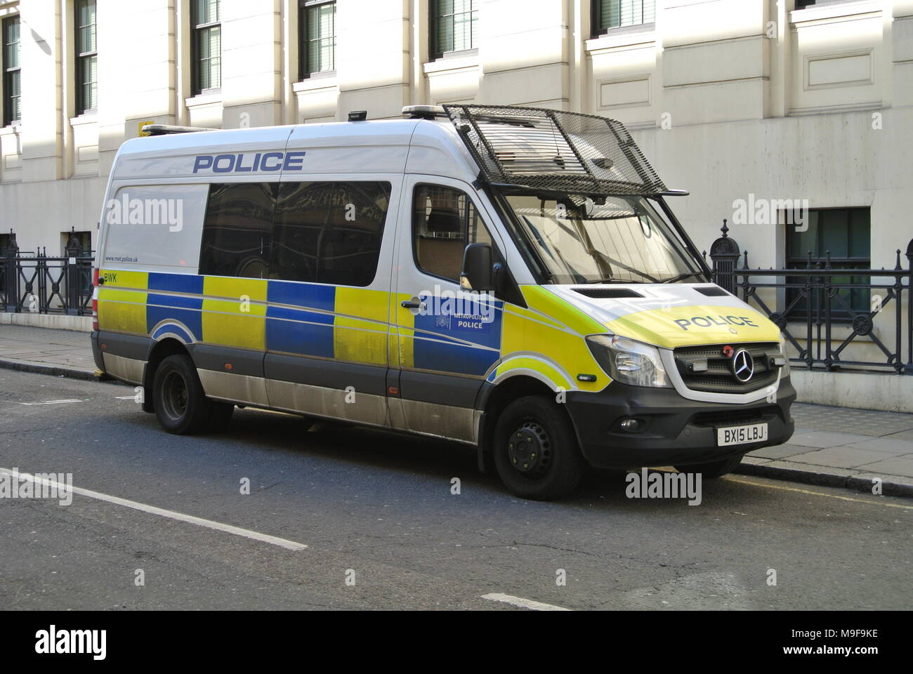 Metropolitan Police marked van parked next to a pavement, London, England, UK - Stock Image