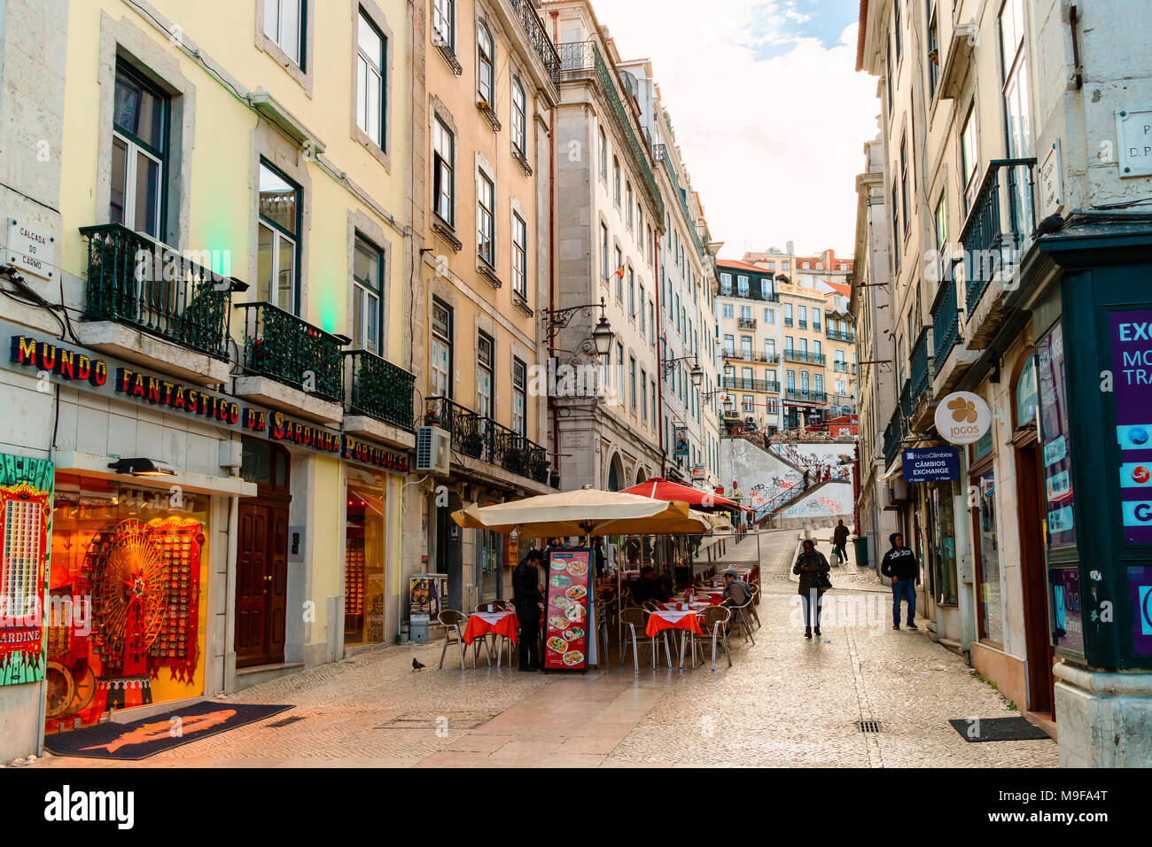 Street view in the old city centre of Lisbon. - Stock Image