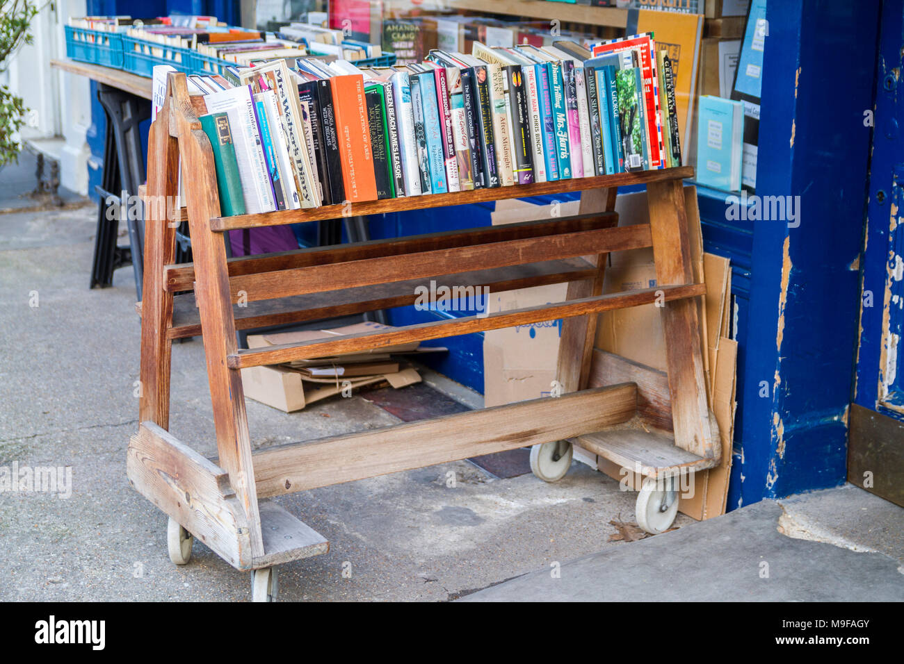 Books on an Old fashioned book trolley bookshop, bookstore with crates of secondhand books outside , London UK book display reading concept education - Stock Image
