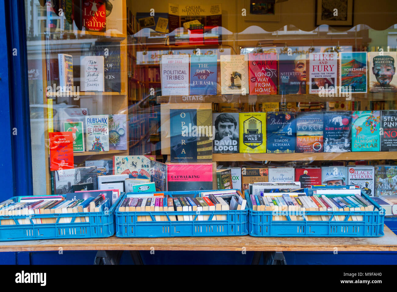 Primrose Hill Books, Old fashioned bookshop, bookstore with crates of secondhand books outside stacked, London UK window book display, window display, Stock Photo