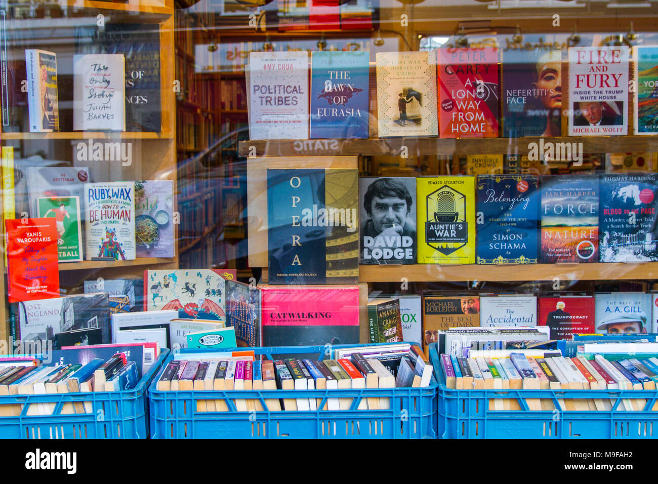 Primrose Hill Books, Old fashioned bookshop, bookstore book shop with crates of secondhand books outside stacked, London UK window book display learn - Stock Image