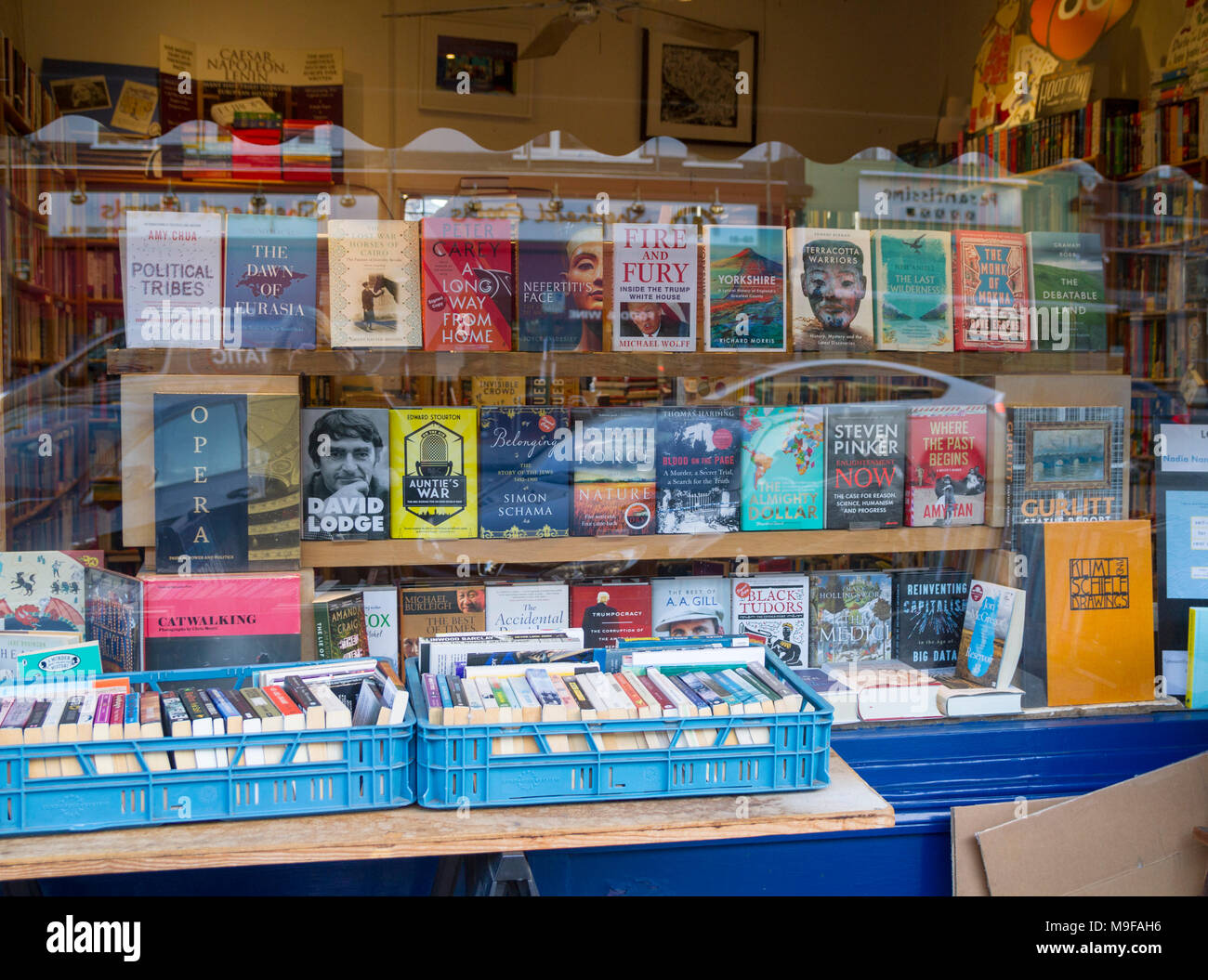 Primrose Hill Books, Old fashioned bookshop, bookstore with crates of secondhand books outside stacked, London UK window book display reading concept Stock Photo