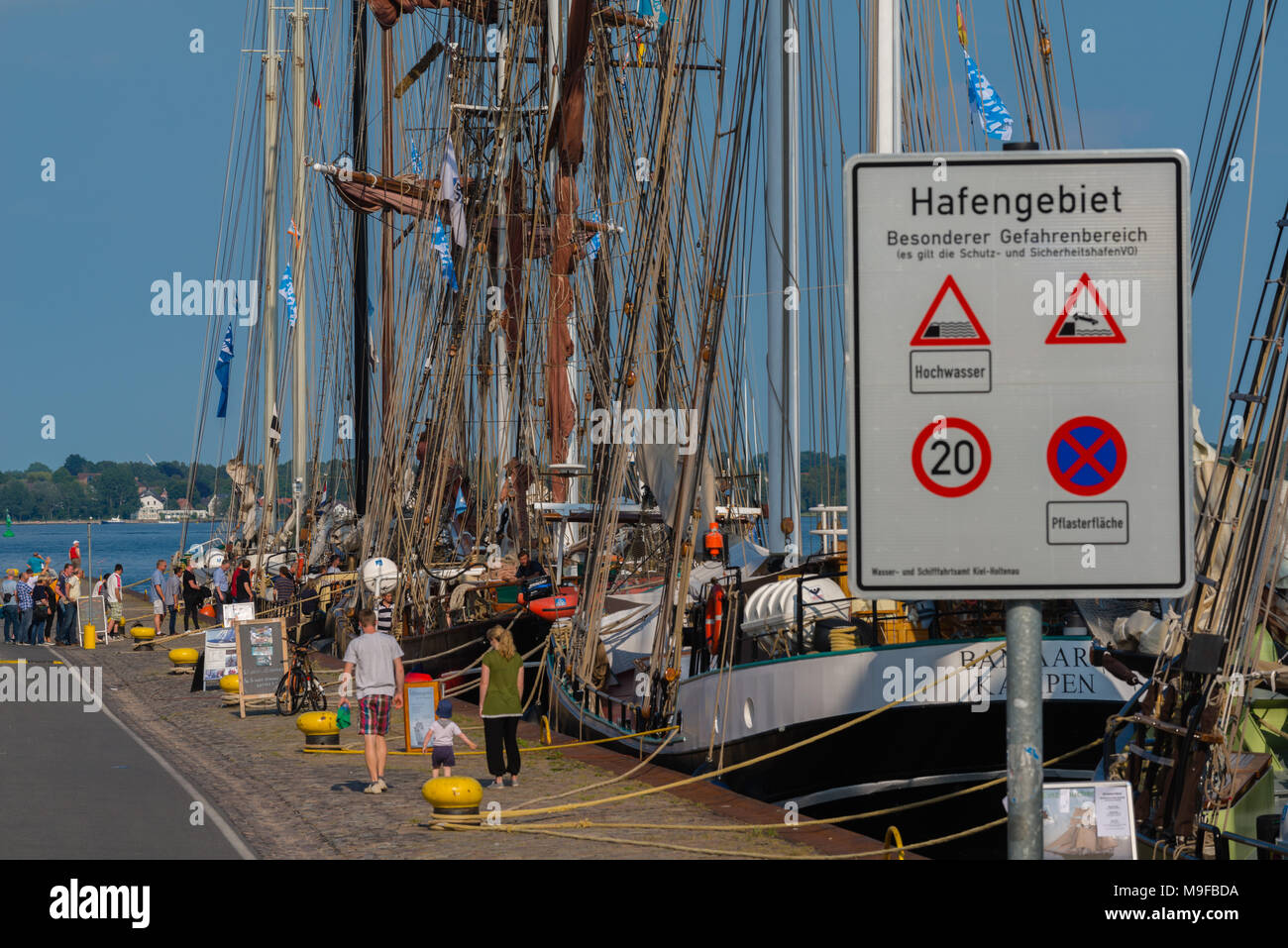 Traditional sailing boats at the pier of Kiel-Holtenau during 'Kiel Week' or 'Kieler Woche', Kiel, Schleswig-Holstein, Germany, Europe - Stock Image