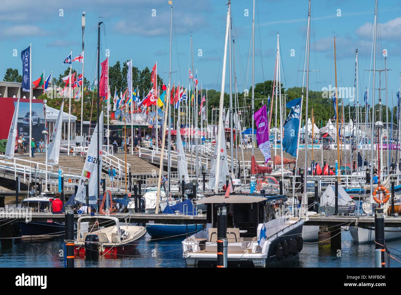 Busy marina at Kiel-Schilksee during 'Kiel Week' or 'Kieler Woche', the worldwide biggest sailing event, Kiel, Schleswig-Holstein, Germany - Stock Image