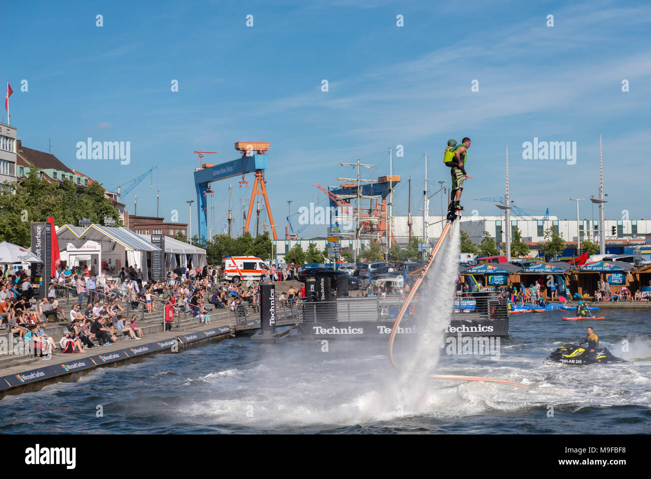 Flyboarder auf Wasserstrahl-Rückstoß, Jetski im Bootshafen, Kieler Woche, Kiel Stock Photo