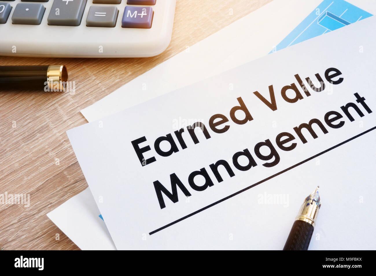 Document Earned Value Management on a desk. - Stock Image