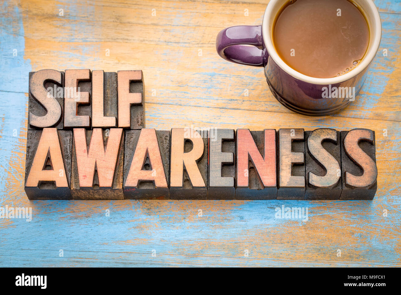 self awareness word abstract in vintage letterpress printing blocks with a cup of coffee - Stock Image