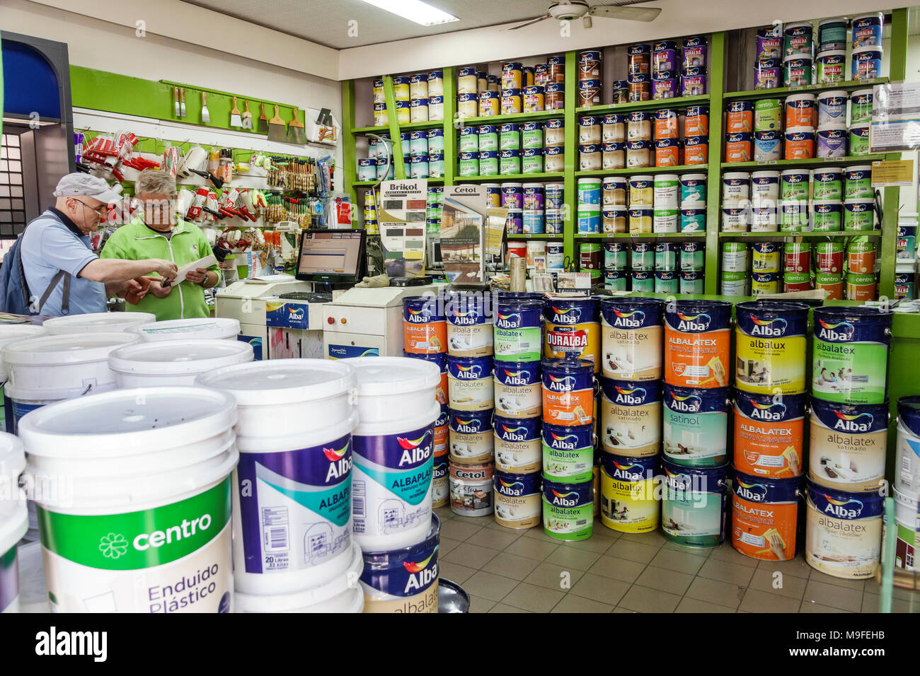 Buenos Aires Argentina Pinturerias del Centro paint store cans house painting supplies home improvement Alba brand man salesman customer Hispanic Argentinean Argentinian Argentine South America American - Stock Image