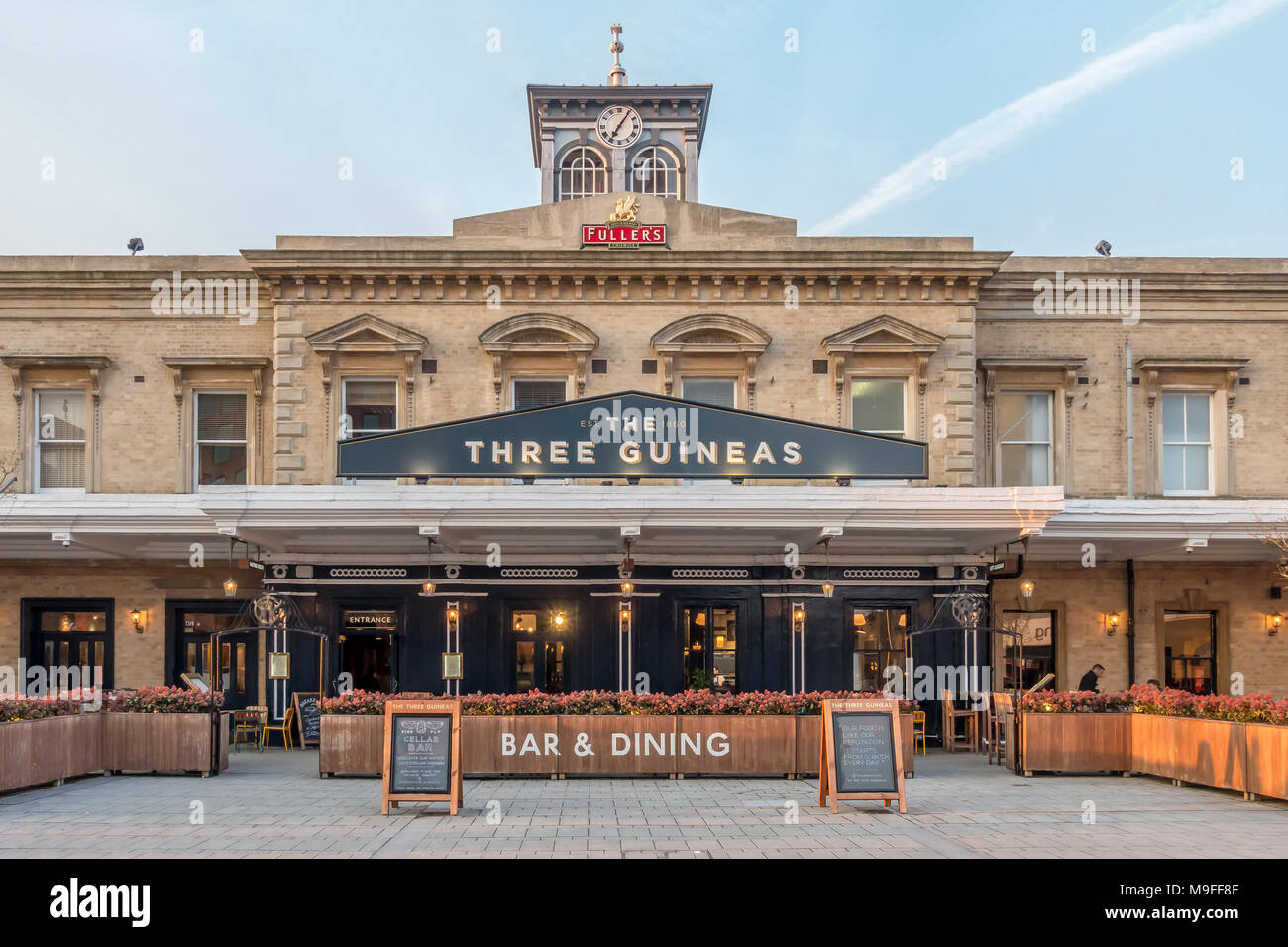 The Three Guineas pub and restaurant is built into the side of Reading Railway Station in Reading, UK. - Stock Image