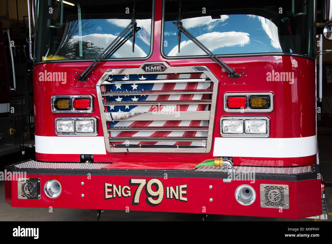 Front view of a KME fire truck parked inside the Speculator Volunteer Fire Department fire house in Speculator, NY USA - Stock Image