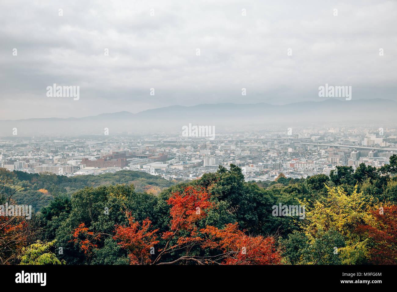 Kyoto city and autumn maple view under cloudy sky at Fushimi Inari shrine in Kyoto, Japan Stock Photo