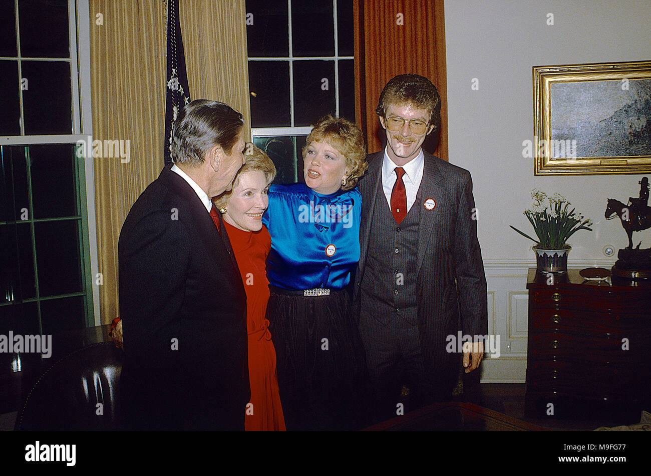 Washington, DC., USA, January 29, 1984 President Ronald Reagan with his wife Nancy and daughter Maureen and son-in-law Dennis Revell after he made his announcement on national television for re-election from  the Oval Office of the White House Credit: Mark Reinstein/MediaPunch - Stock Image