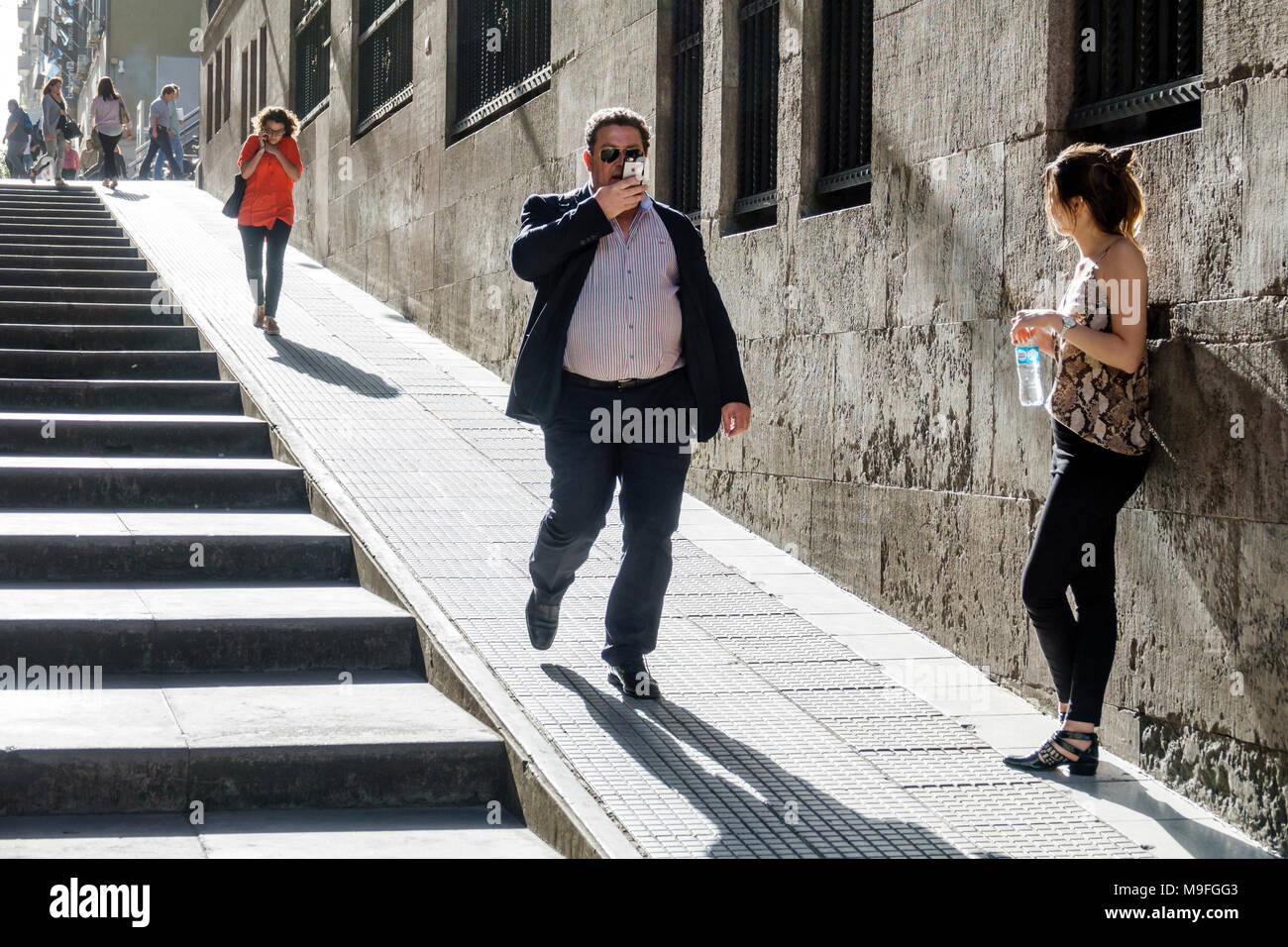 Buenos Aires Argentina Microcentro financial center pedestrian street incline uphill stairs man woman shadow walking Hispanic Argentinean Argentinian Argentine South America American - Stock Image