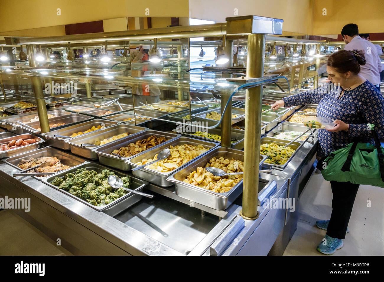 Buenos Aires Argentina Microcentro Restaurant Pekin Comida de China restaurant interior Asian food buffet self-serve chafing trays sneeze guard food safety woman Hispanic Argentinean Argentinian Argentine South America American - Stock Image