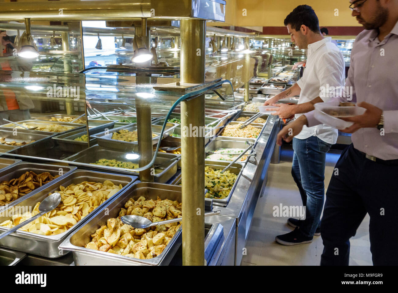 Buenos Aires Argentina Microcentro Restaurant Pekin Comida de China restaurant interior Asian food buffet self-serve chafing trays sneeze guard food safety man young adult Hispanic Argentinean Argentinian Argentine South America American Stock Photo