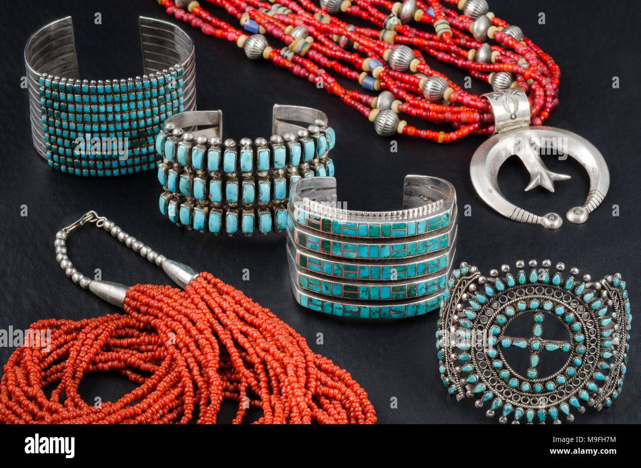 Collection of Native American Turquoise, Silver and Coral Bead Jewelry. Cuff Bracelets and Bead Necklaces. Stock Photo