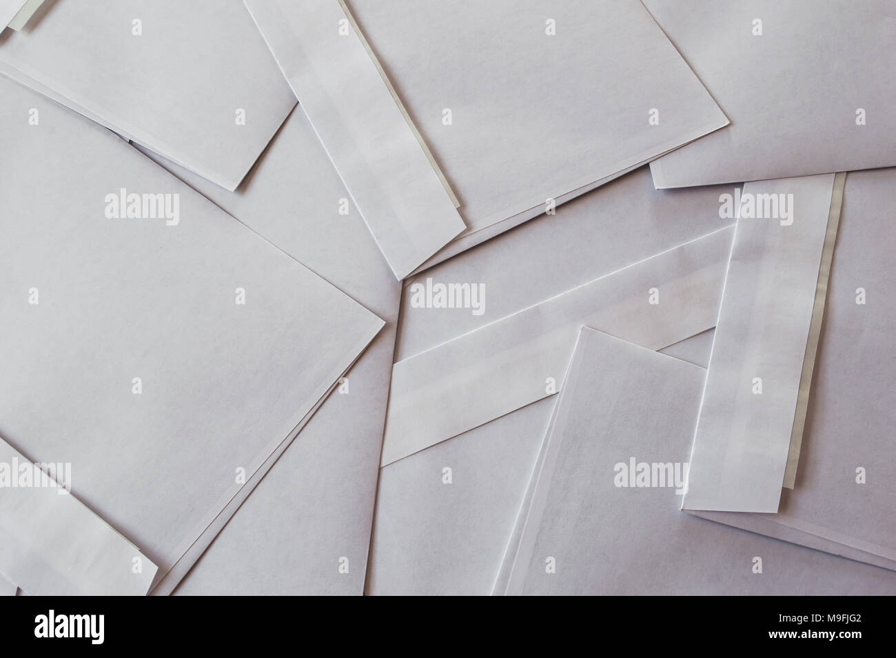 Background full of white letters envelopes. - Stock Image